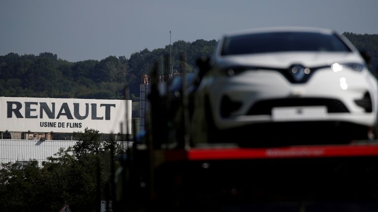 A car carrier transporting Renault ZOE cars leaves the Flins plant of French carmaker Renault in Aubergenville, west of Paris, following the outbreak of the coronavirus disease (COVID-19) in France, May 26, 2020