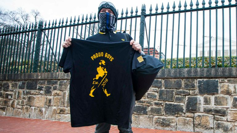 A member of the Virginia chapter of the Proud Boys sells T-shirts Pic: AP Photo/John C. Clark