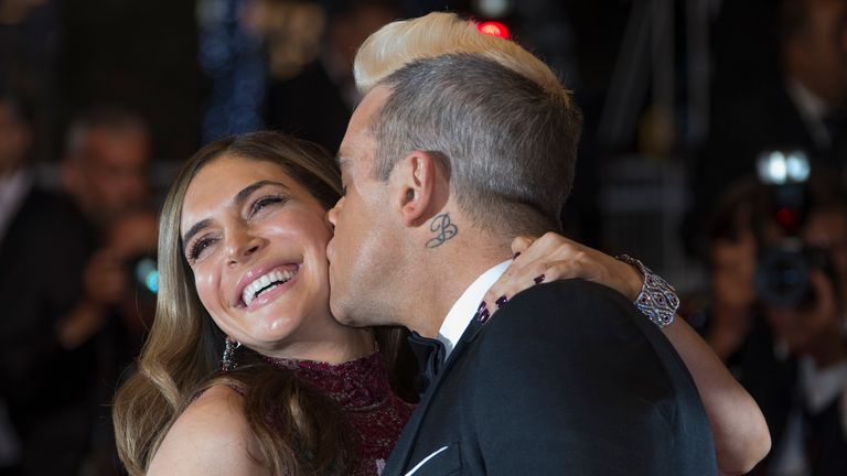 "Singer Robbie Williams (R) kisses his wife Ayda Field as they pose on the red carpet for the screening of the film ""The Sea of Trees"" in competition at the 68th Cannes Film Festival in Cannes, southern France, May 16, 2015. REUTERS/Yves Herman TPX IMAGES OF THE DAY"