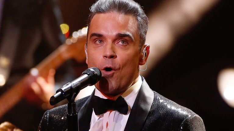 Singer Robbie Williams performs during the Bambi 2016 media awards ceremony in Berlin, Germany, November 17, 2016 REUTERS/Hannibal Hanschke