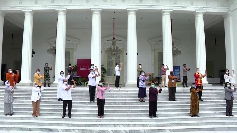 Officials on steps