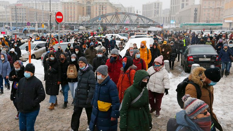 People walk on a street in Moscow during a protest against the jailing of opposition leader Alexei Navalny. Pic: Associated Press