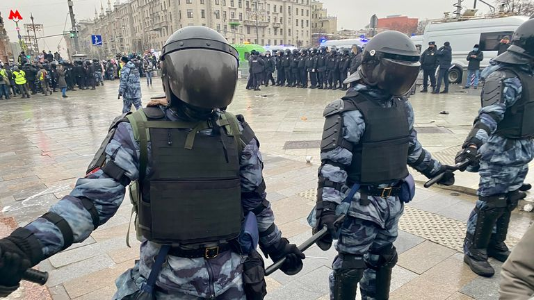 Police link batons in Moscow