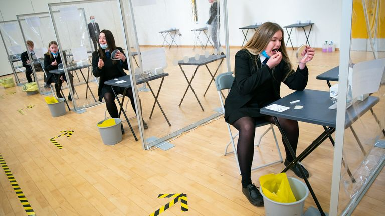 Students taking a COVID-19 test at Oasis Academy in Coulsdon, Surrey