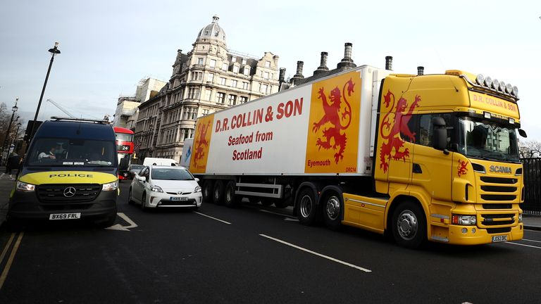 A lorry drives during a protest against post-Brexit bureaucracy that hinders exports to the European Union, at the Parliament Square in London, Britain, January 18, 2021. REUTERS/Hannah McKay