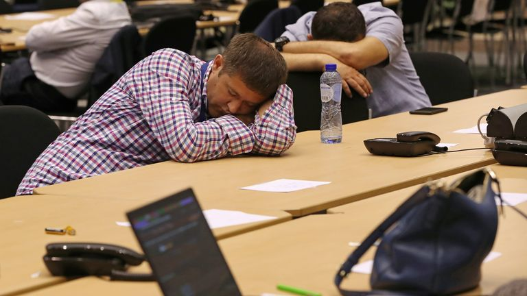 Journalists sleep while waiting for the end of a European Union leaders summit that aims to select candidates for top EU institution jobs, in Brussels, Belgium July 1, 2019. REUTERS/Yves Herman