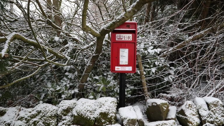 A postbox among snow-covered trees in Hollow Meadows, near Sheffield.