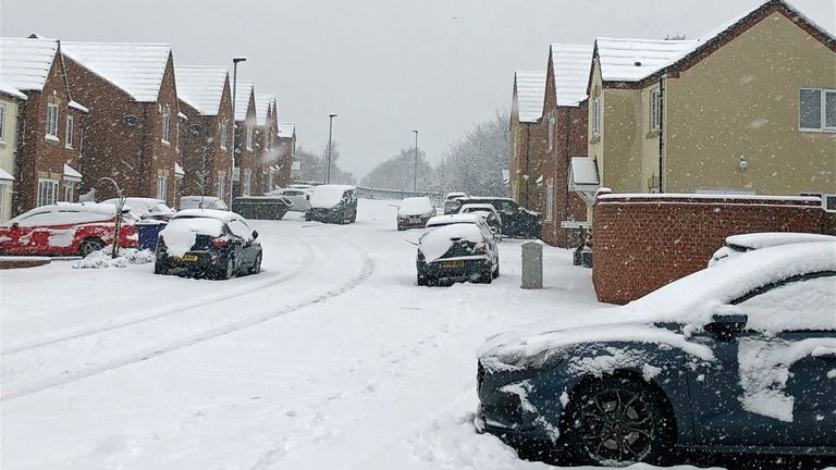 Snow covers a road in Monk Bretton, Barnsley, South Yorkshire, after the Met Office issued an amber snow warning for parts of Scotland and northern England overnight into Thursday, with up to 11cm falling in the Perth and Kinross area and 5cm in Cumbria by 9am, and large accumulations elsewhere.