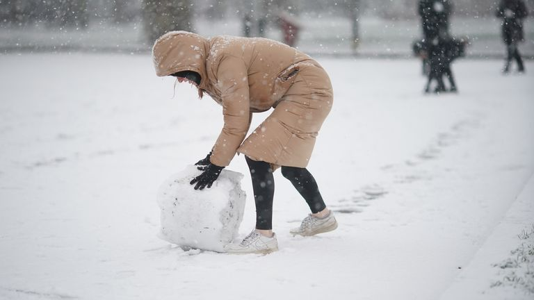 People in the snow in Battersea Park, London