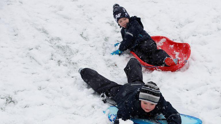 Children play in the snow in Hemel Hempstead