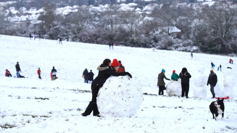 People enjoy the snow in Guildford, Surrey