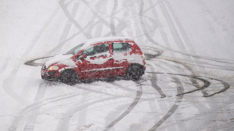 A car spins on a snow covered road near Mountsorrel in Leicestershire