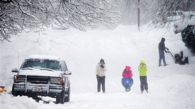 Pic: AP Alyssa Crall and her sisters Ava and Rhyan walk along Spring Street in Omaha, Neb., Sunday Feb. 1, 2015, as they head to a nearby hill to go sledding. A slow-moving winter storm blanketed a large swath of the Plains and Midwest in snow Sunday, forcing the cancellation of more than 1,500 flights, and making roads treacherous. according to the National Weather Service.(AP Photo/The Omah