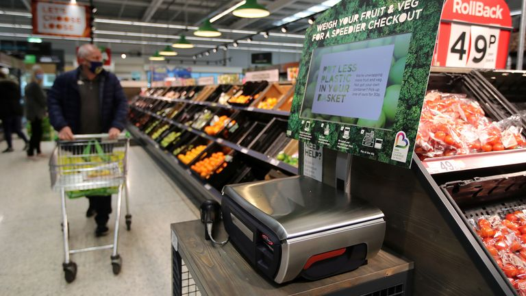Scales to weigh loose fresh produce are seen in the UK supermarket Asda, as the store launches a new sustainability strategy, in Leeds, Britain, October 19, 2020. Picture taken October 19, 2020. REUTERS/Molly Darlington