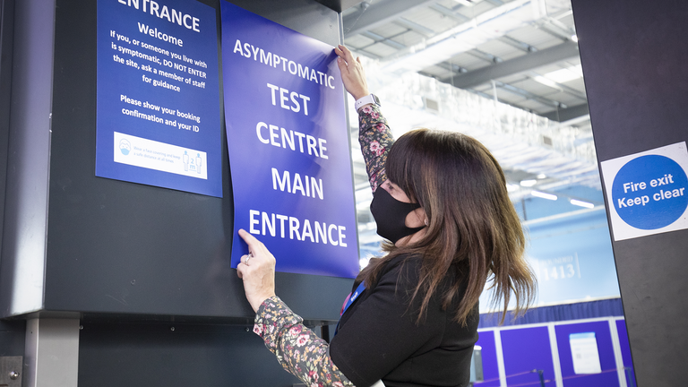 Students get a Covid-19 test at a mass testing centre set up at the sports centre at St Andrews University, ahead of the Christmas holiday.