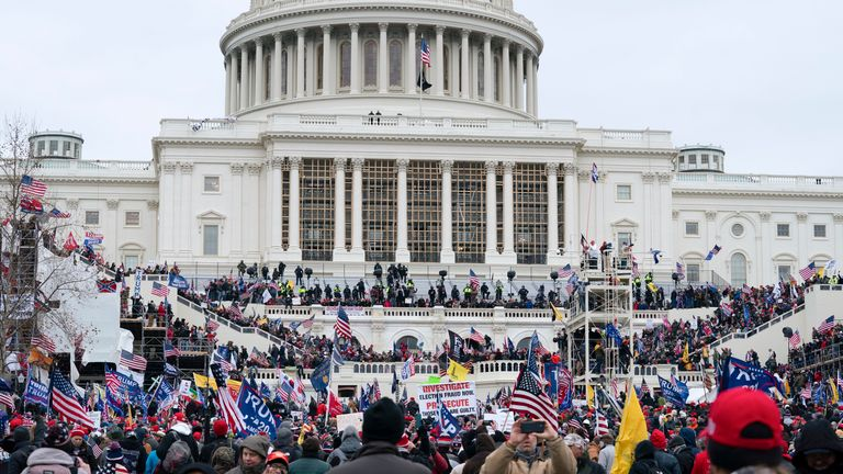 Support of President Donald Trump storm the west side of the the U.S. Capitol on Wednesday, Jan. 6, 2021, in Washington. (AP Photo/Jose Luis Magana)