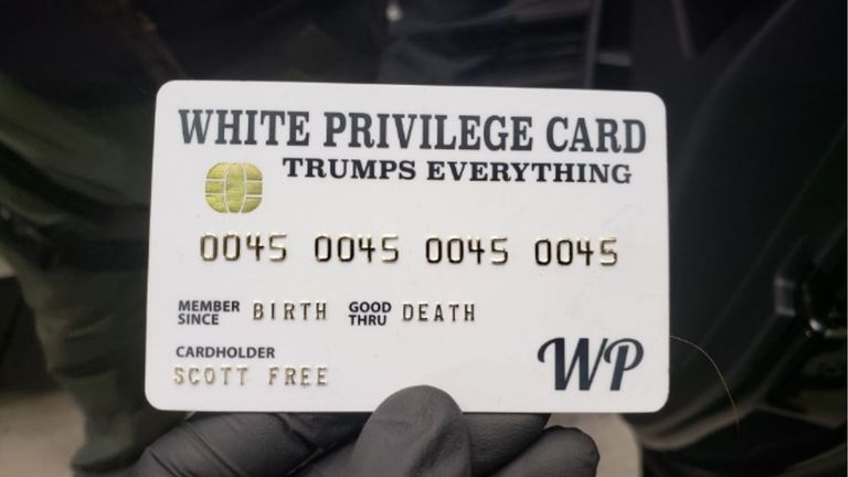 A mock credit card was found emblazoned with the slogan White Privilege, Trumps Everything
