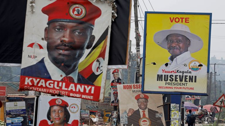 Elections billboards for Uganda's President Yoweri Museveni, and opposition leader and presidential candidate Robert Kyagulanyi, also known as Bobi Wine, are seen on a street in Kampala, Uganda January 12, 2021. REUTERS/Baz Ratner
