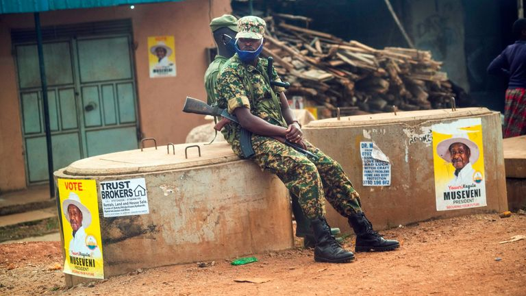 Ugandan security forces on patrol a checkpoint Kampala, Uganda, Saturday Jan. 16, 2021, after Ugandan President Yoweri Kaguta Museveni was declared winner of the presidential elections.