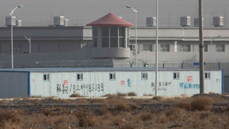 A guard tower and barbed wire fences at a facility in Xinjiang, China