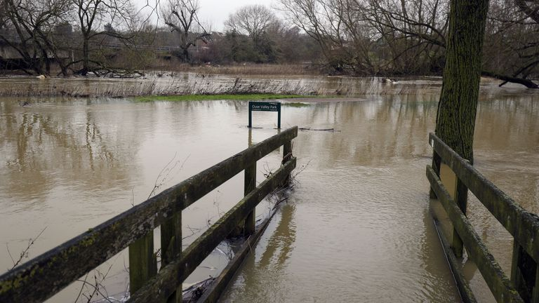 A partially submerged walkway next to the River Great Ouse in Haversham, Buckinghamshire. Heavy snow and freezing rain is set to batter the UK this week, with warnings issued over potential power cuts and travel delays.