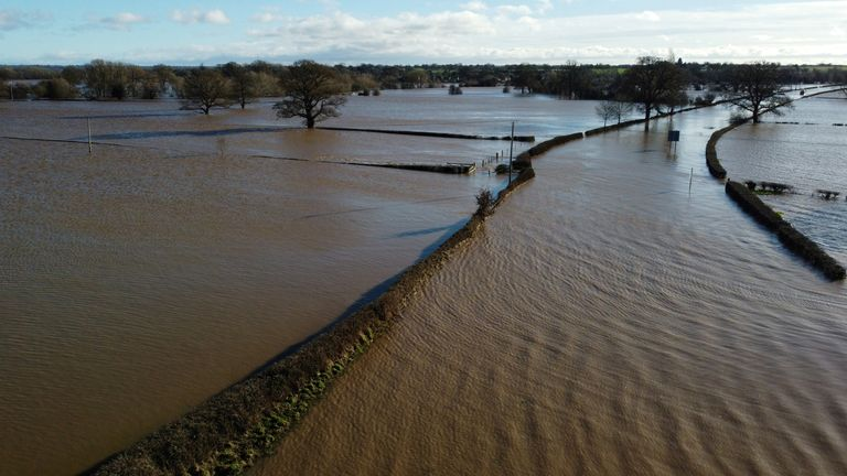 A flooded road and fields are seen after storm Christoph arrived in Bangor-on-Dee, Britain, January 21, 2021. Picture taken with a drone. REUTERS/Phil Noble