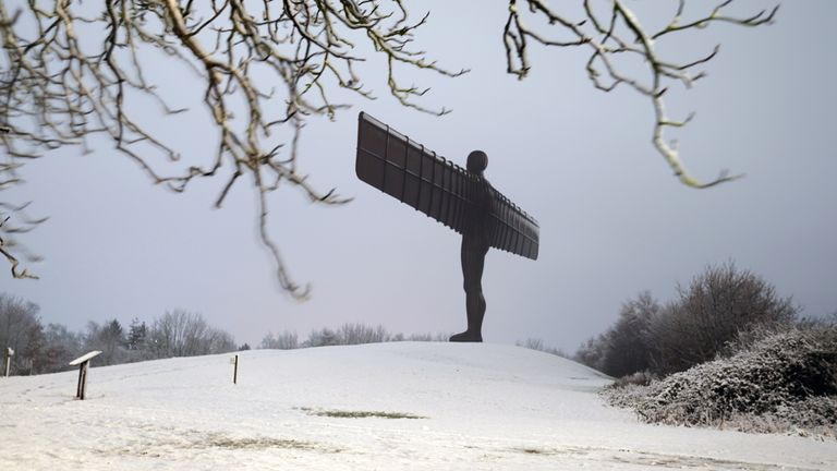 the 20 metre tall Angel of the North sculpture, designed by Antony Gormley, in Gateshead, Tyne and Wear, during the night after heavy snow blanketed much of the north of England.