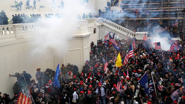 Pro-Trump supporters clash with police at US Capitol