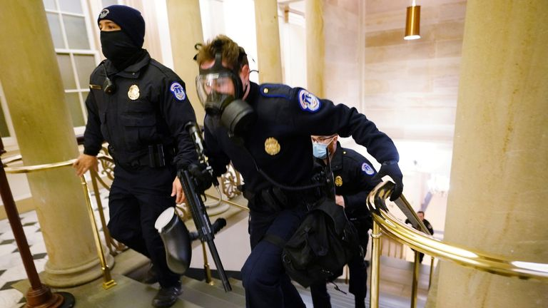 U.S. Capitol police officers take positions as protestors enter the Capitol building during a joint session of Congress to certify the 2020 election results on Capitol Hill in Washington, U.S., January 6, 2021. Kevin Dietsch/Pool via REUTERS
