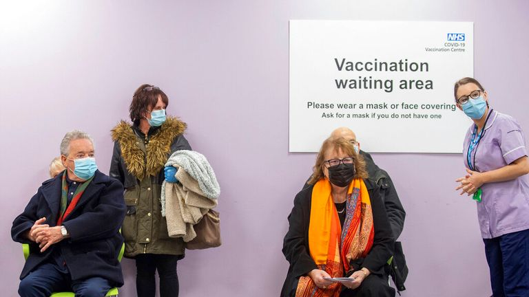 Patients wait to receive a Covid-19 vaccine at the NHS vaccine centre that has been set up at Robertson House in Stevenage, England, Monday Jan. 11, 2021. The centre is one of the seven mass vaccination centres now opened to the general public as the government continues to ramp up the vaccination programme against Covid-19. (Joe Giddens/Pool via AP)