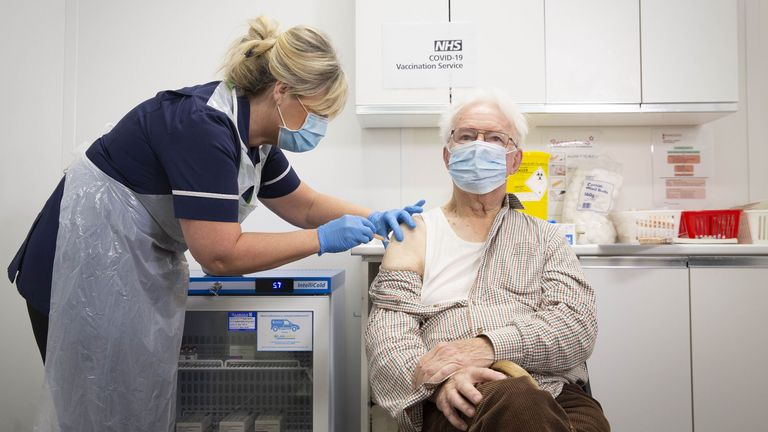 Peter Cast, 87, receives his vaccine at a Superdrug store in Guildford, Surrey