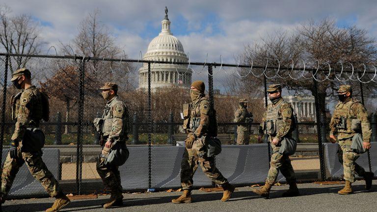 Members of the National Guard patrol near the US Capitol building ahead of President-elect Joe Biden's inauguration in Washington DC