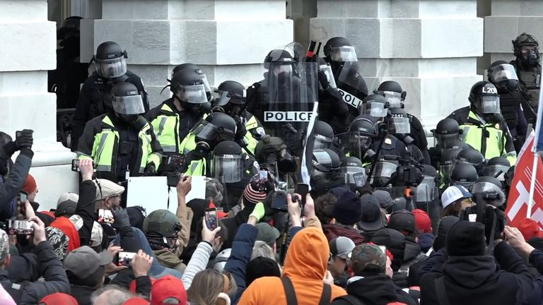 Riot police clash with protesters outside Capitol building