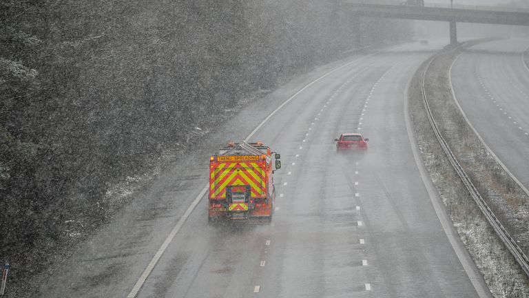 A gritter spreads salt on the M4 near Pencoed in South Wales