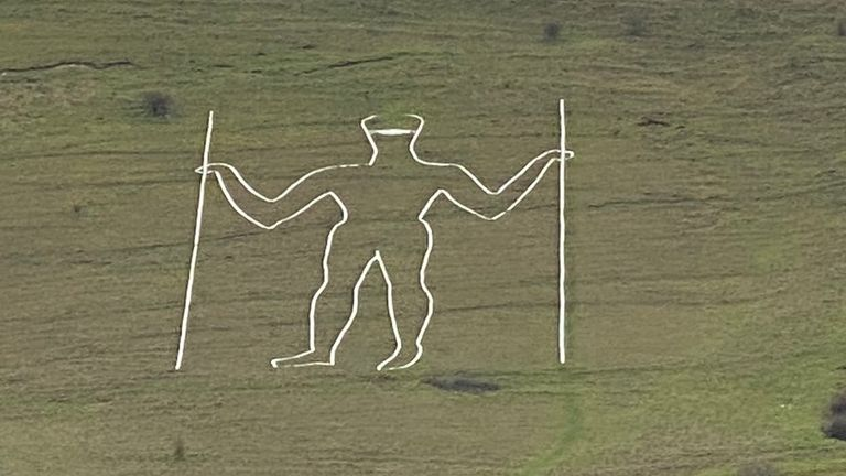 A picture of the Long Man of Wilmington, which was defaced when a mask was painted on it. Pic: @Jeremy_Christey