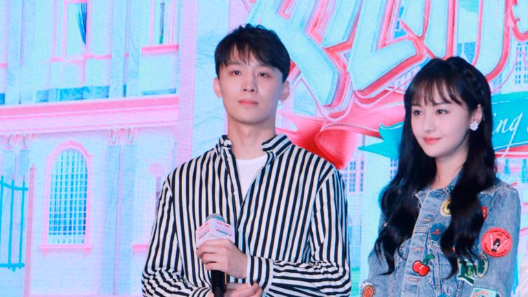 "Chinese actress Zheng Shuang, right, and her boyfriend Zhang Heng attend a press conference for reality show ""Meeting Mr. Right"" Season 2 in Shanghai, China, 22 August 2019. (Imaginechina via AP Images)"