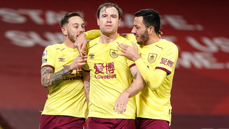 Ashley Barnes (centre) celebrates scoring for Burnley against Liverpool