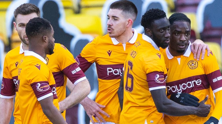 Devante Cole celebrates with team-mates after scoring for Motherwell against Rangers