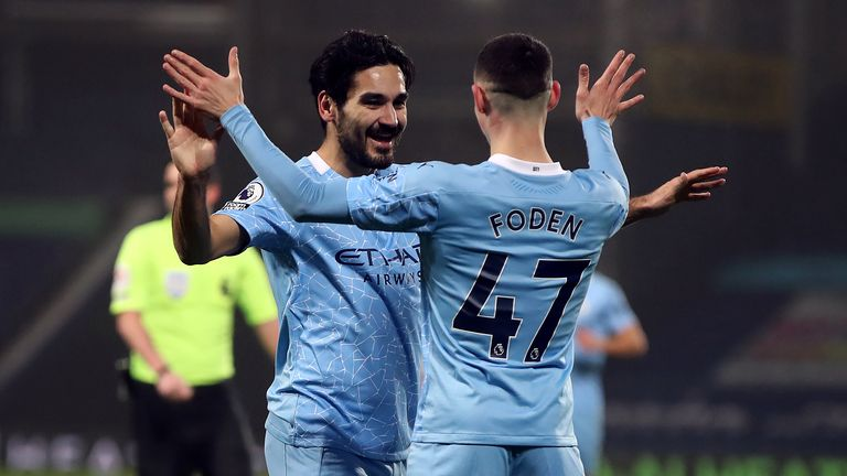 Ilkay Gundogan celebrates scoring his second, Man City's third goal of the game