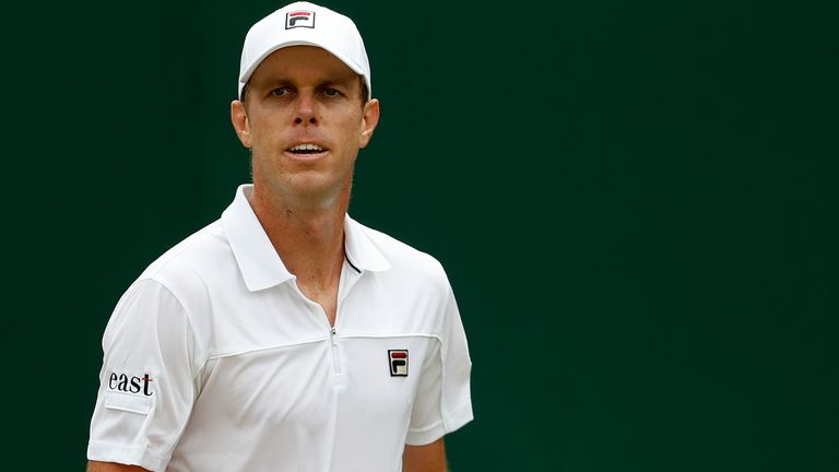 Sam Querrey reacts after winning a point against Australia's John Millman in a Men's singles match during day six of the Wimbledon Tennis Championships in London, Saturday, July 6, 2019.