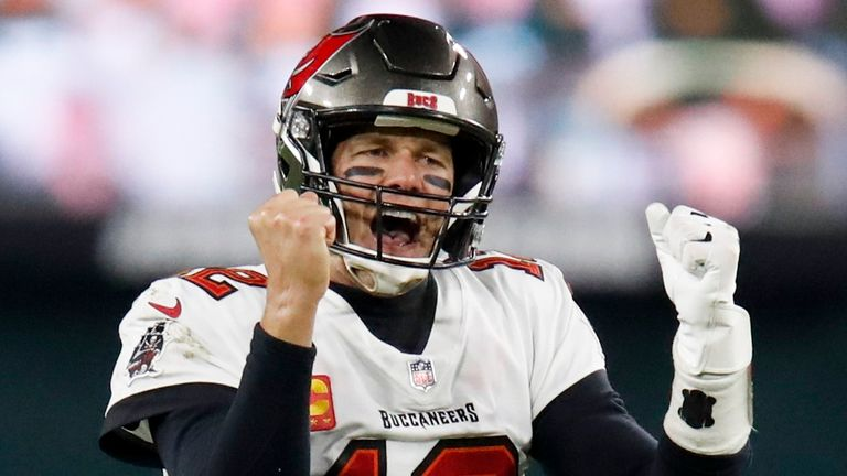 Tampa Bay Buccaneers quarterback Tom Brady celebrates after winning the NFC Championship Game (AP Photo/Matt Ludtke)..