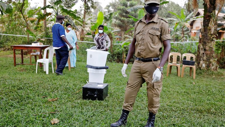 police officer stands guard at a voting center during the presidential elections in Kampala, Uganda, January 14, 2021. REUTERS/Baz Ratner