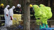 Investigators covered a bench where Russian double agent Sergei Skripal was found after being poisoned