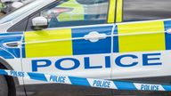 Police car and cordon. File pic