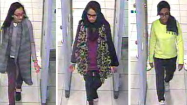 FILE - This is a Monday Feb. 23, 2015 file handout image of a three image combo of stills taken from CCTV issued by the Metropolitan Police Kadiza Sultana, left, Shamima Begum, centre and and Amira Abase going through security at Gatwick airport, before they caught their flight to Turkey. The Dutch man who married a British teenager after she ran away to join the Islamic State group says he wants to return home to the Netherlands with Shamima Begum and their newborn son. Yago Riedijk tells the B