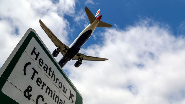 A British Airways plane lands at Heathrow in London, as new quarantine measures for international arrivals come into force.