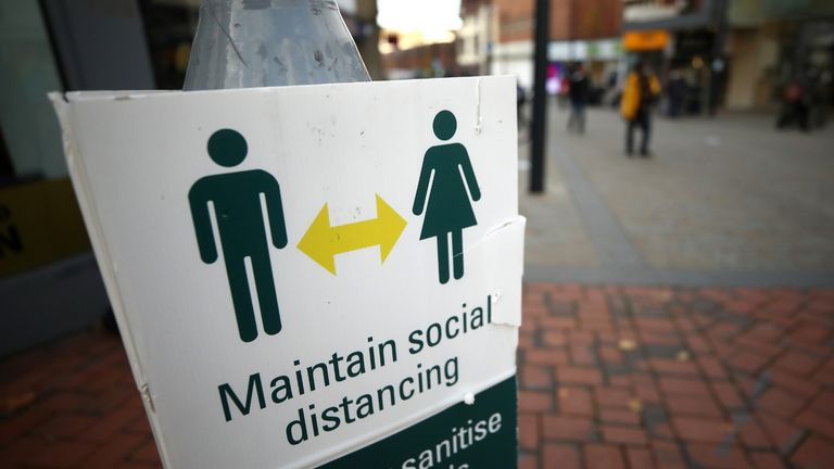 A social distancing sign in Derby city centre, ahead of a national lockdown for England from Thursday.