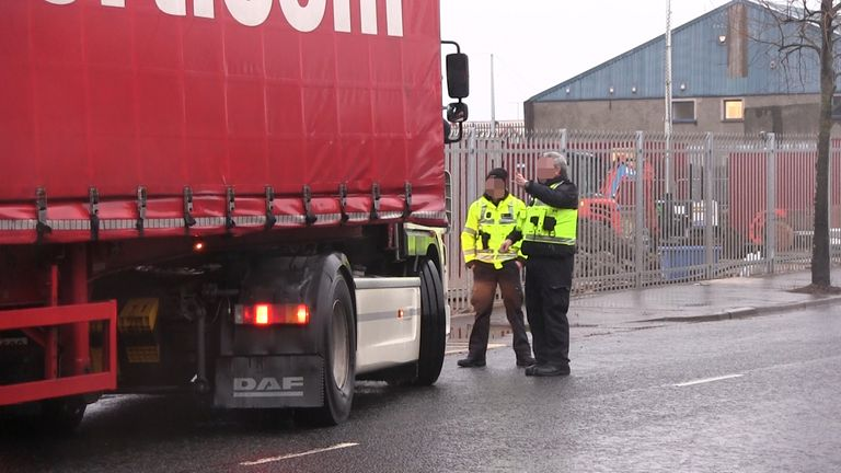 IMAGE PIXELLATED BY PA PICTURE DESK Border Force officers talk to a lorry driver at a checking facility near Belfast Port, as outgoing Stormont minister Edwin Poots has appealed for calm heads after Brexit port checks were suspended over threatening loyalist behaviour.