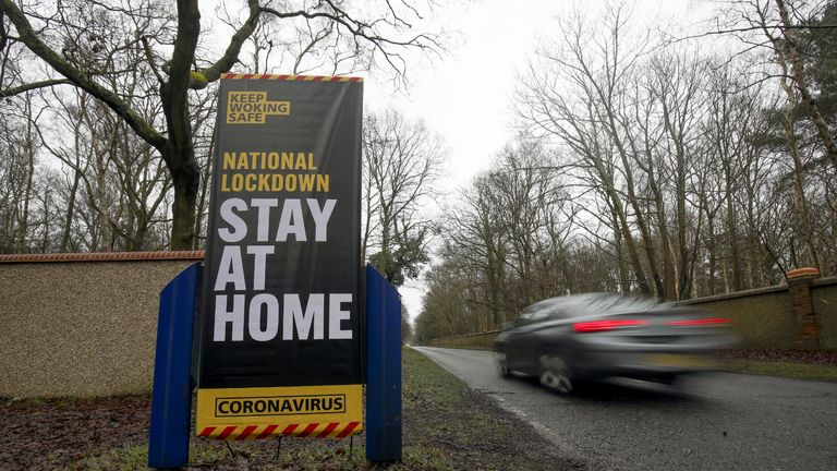 A car drives past a coronavirus information sign in Brookwood, Surrey, during England's third national lockdown to curb the spread of coronavirus. Picture date: Wednesday January 27, 2021.