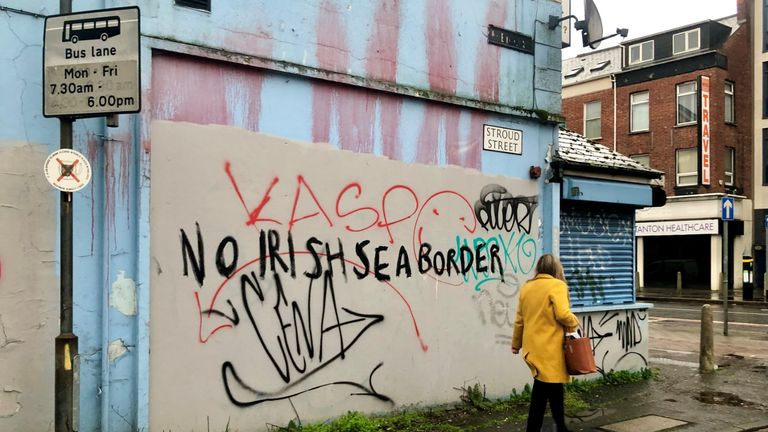 Graffiti reading 'No Irish Sea border' near Belfast City centre. Outgoing Stormont minister Edwin Poots has appealed for calm heads after Brexit port checks were suspended over threatening loyalist behaviour.